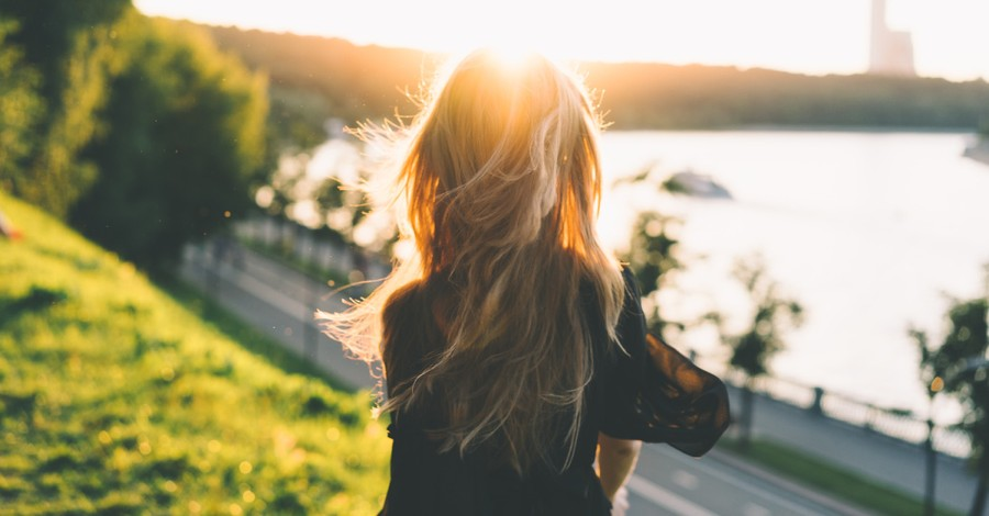 A woman in the sun, Kelsey Grimm encourages people struggling with their mental health to find their worth in Christ