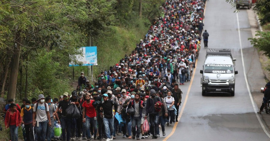 A migrant caravan, a survey shows that the 'great replacement' belief correlates with Christian nationalism