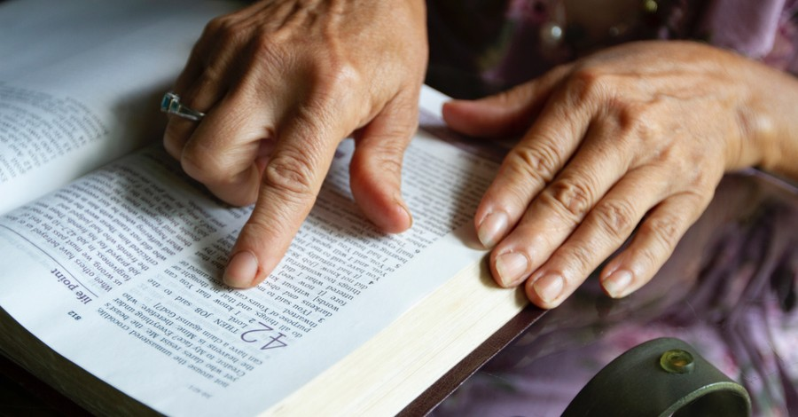 A hand following along in the Bible, The importance of seeking God's power over our Enemy