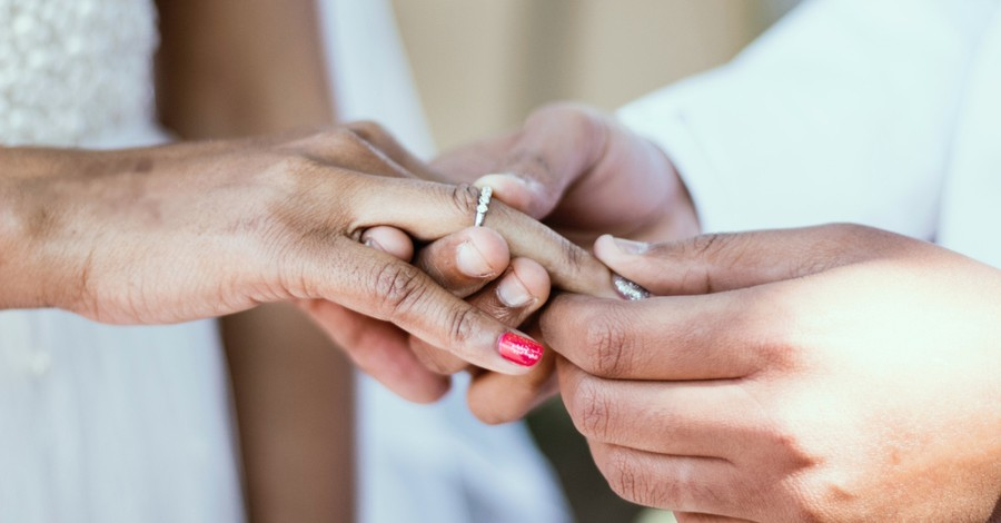 People exchanging rings, fewer Americans believe the presence of more married couples will better society