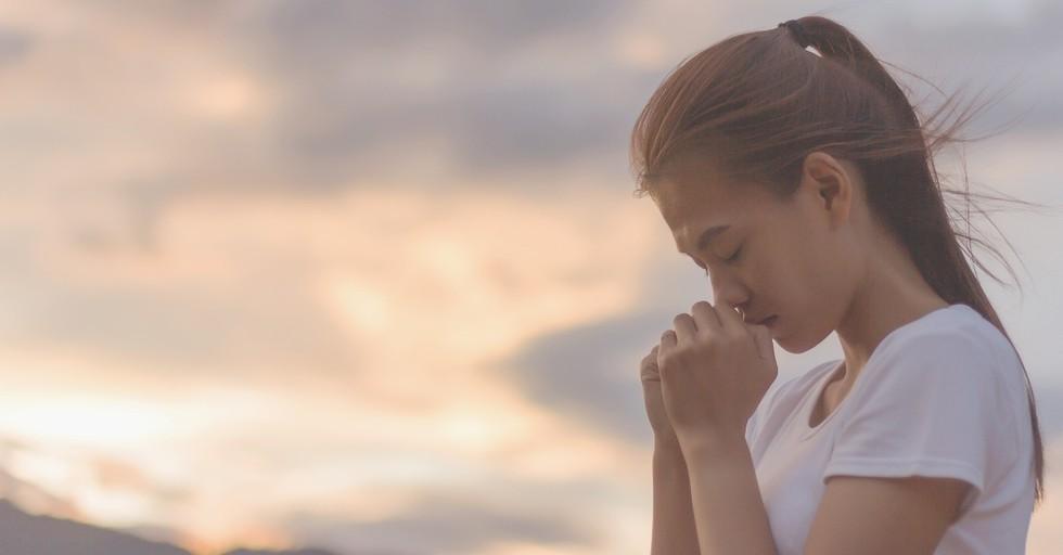 woman praying fervently