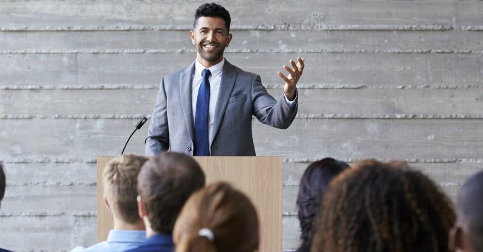pastor smiling preaching sermon to audience