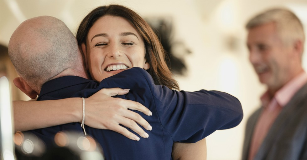 woman and man hugging in church